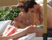 Lauren Conrad was spotted cozying up with her new boyfriend William Tell at a resort in Cabo San Lucas