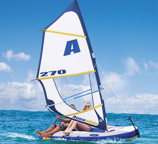 Hammacher Schlemmer inflatable sailboat and windsurfer