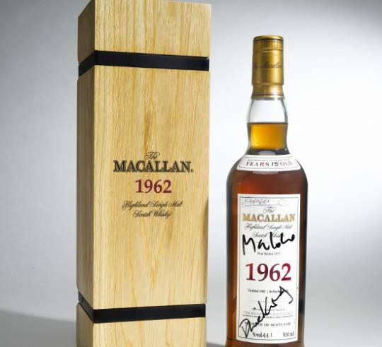 1962 Macallan whisky bottle signed by Skyfall cast