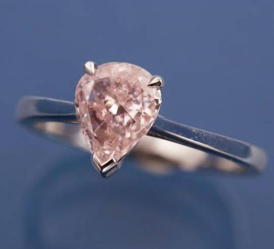 Gold ring with single carat pink diamond