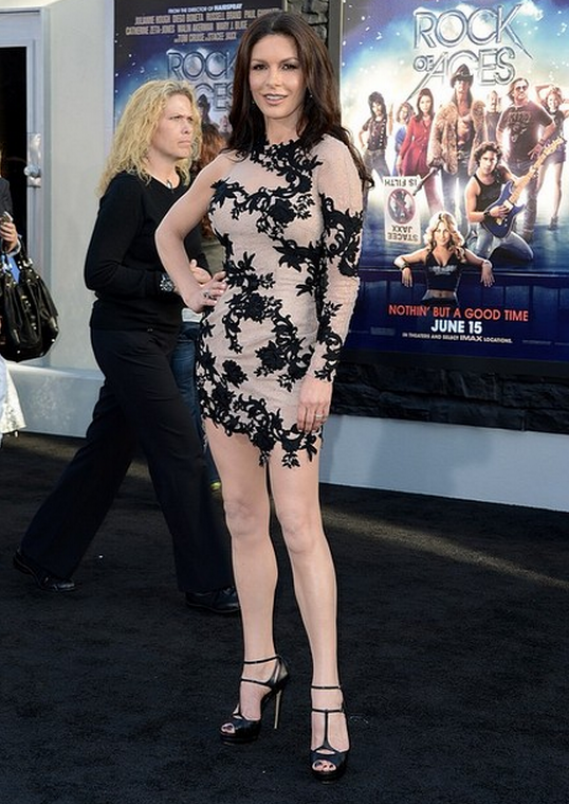 Catherine Zeta-Jones flaunted her designer sandals to the premiere of the movie 'Rock of Ages' in Los Angeles.