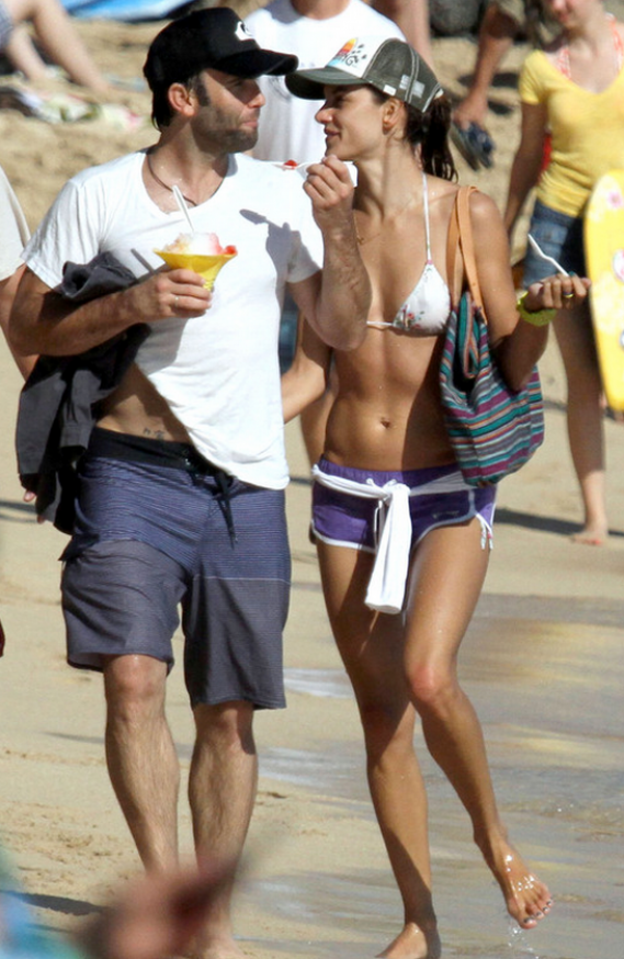 Alessandra Ambrosio was photographed by the paparazzi vacationing in the exotic beach resort of Hawaii in August 2011.