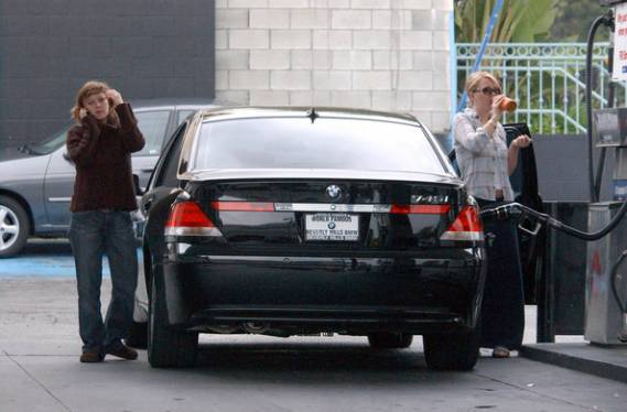 Drew Barrymore was recently photographed refueling the fuel tank of her brand new metallic black BMW 745i at a Los Angeles gas station.