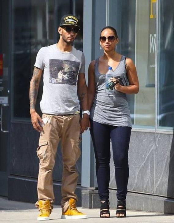 It seemed a strange combination when Swizz Beatz chose yellow sneakers to go along with his greys and browns but that has been the way of life for the songster.
