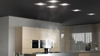 The Frecan Paradigma system combines a range hood and lighting into the ceiling