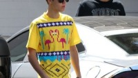 Justin Bieber with his car