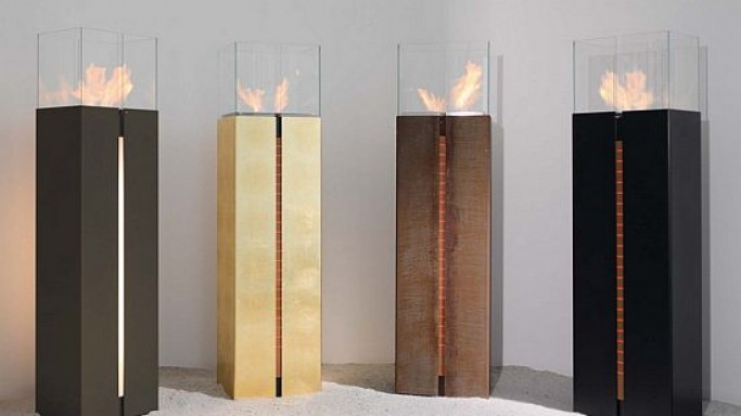 Gold fireplace from Wodtke Germany is wrapped in 24 carat gold