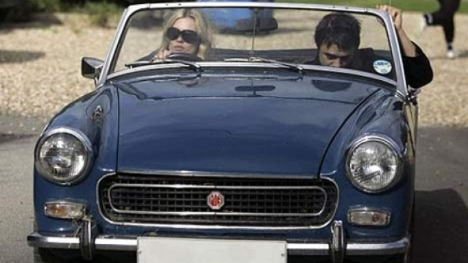 "The famous celebrity also owns a unit-construction car, the ""MG Midget Mk III"""