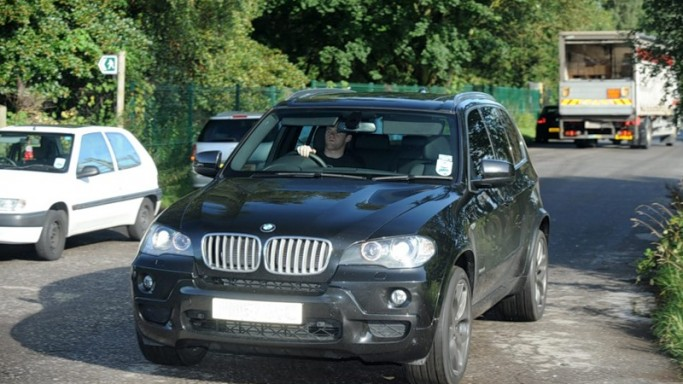 Wayne Rooney drives BMW X5