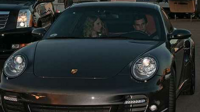 Taylor Lautner was spotted with his co-star Taylor Swift in his $130,000 Porsche 911 Turbo