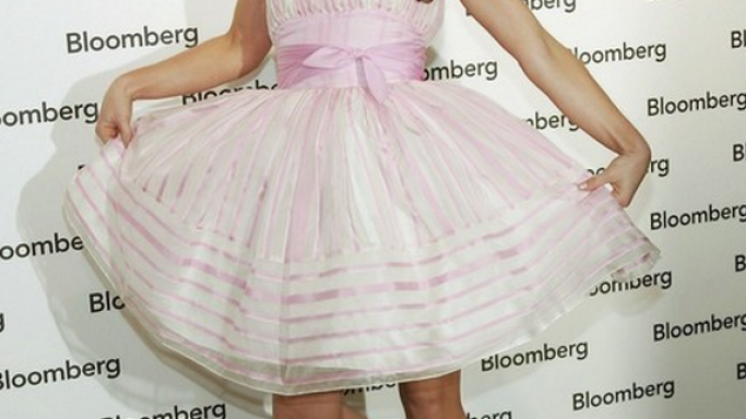 Evangeline Lilly loves to wear the Betsey Johnson Spring dress and the pink bow sandals of the same brand.