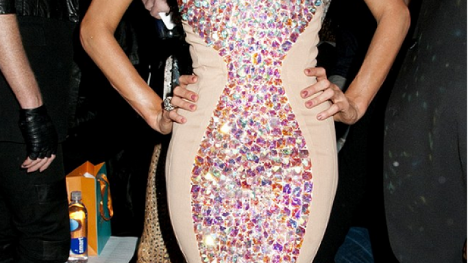 Paris Hilton was spotted wearing  a very cleavage-enhancing pink jewel encrusted dress at The Blonds fashion show at NYC Milk Studio.